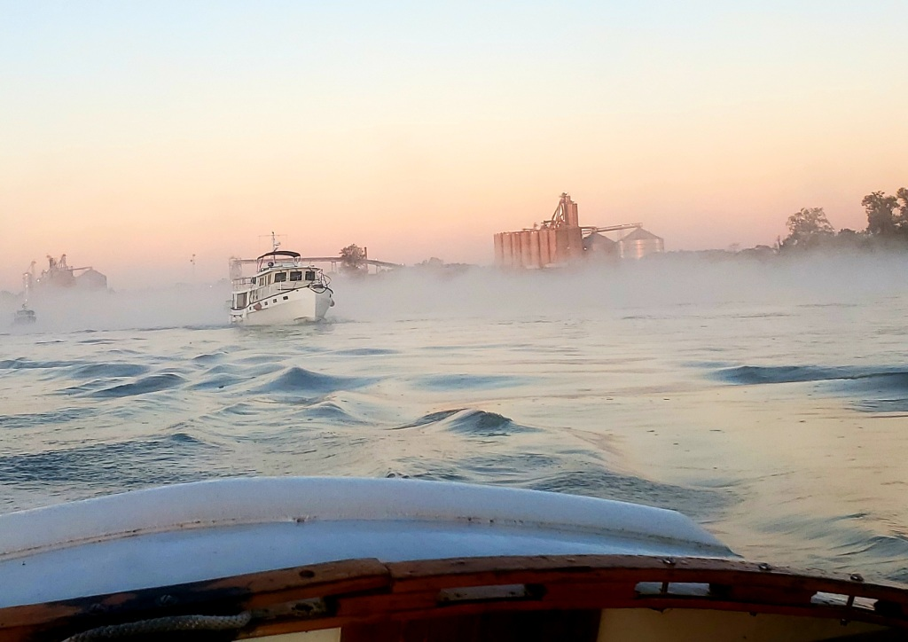 This image has an empty alt attribute; its file name is boats-in-fog-on-ohio.jpg